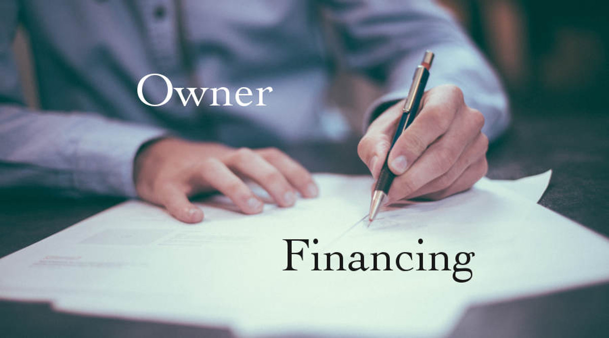 Man in blue shirt with pen in hand writing on document with words on image, Owner Financing.