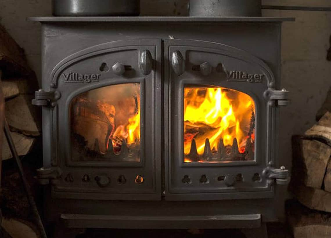 black wood burning stove with fire burning in it